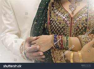 Indian Bride And Groom Holding Hands After Getting Married ...