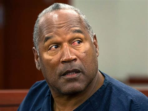 PHOTO: O.J. Simpson waits to continue testifying after a