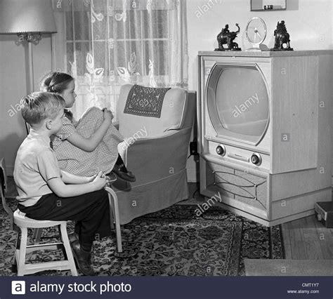 War For Your Living Room Stocks by 1950s Boy And Tv In Living Room Stock Photo