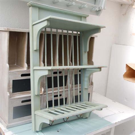 blue wooden plate rack wall mounted