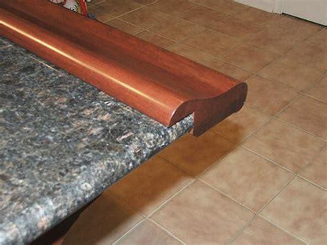 padded bar stools chicago bar rail fastened to granite
