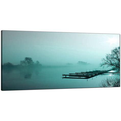 large teal canvas of a river landscape