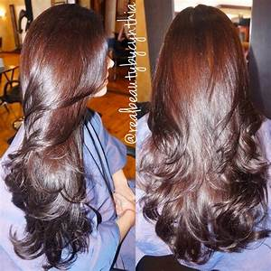 Rich auburn brown with a layered cut love the shine and ...