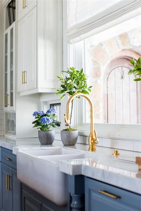 blue cabinets  antique brass gooseneck faucet transitional kitchen benjamin moore