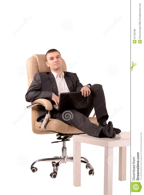 sitting in a chair stock photo image of laptop