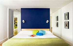 Royal blue painted bed room and coral bedroom