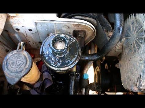 power steering fluid foaming overflowing pump