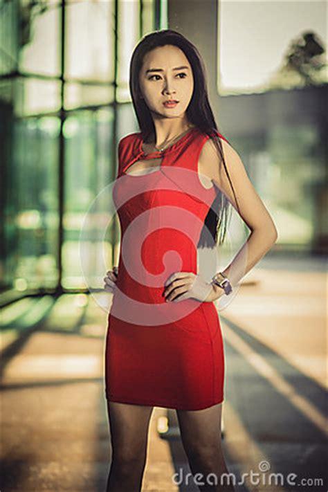 beautiful asian girl model  red dress posing