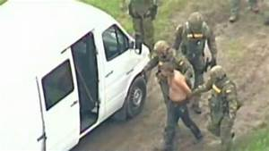 Charges dropped against man arrested in fiery standoff in...
