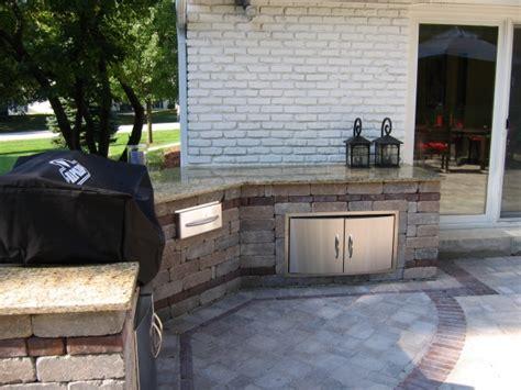 outdoor kitchen area with granite countertop oberndorfer