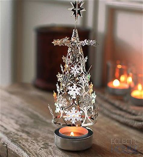 christmas tree silver spinning carousel rotary tea light