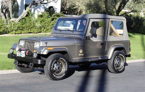 mile  jeep wrangler sahara  sale  bat auctions