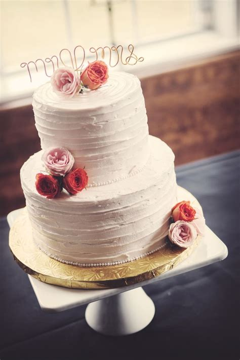 Two Tier Buttercream Wedding Cake With Pink Flowers And