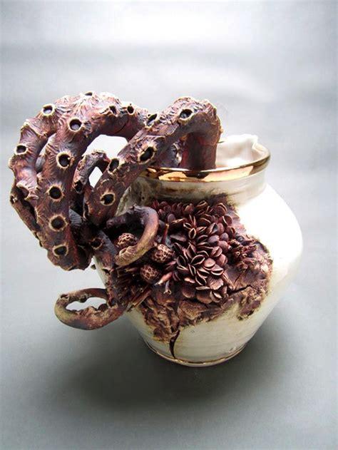 bottom feeders ceramic objects encrusted  marine life