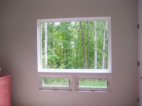 hang curtains wide and high a window to add
