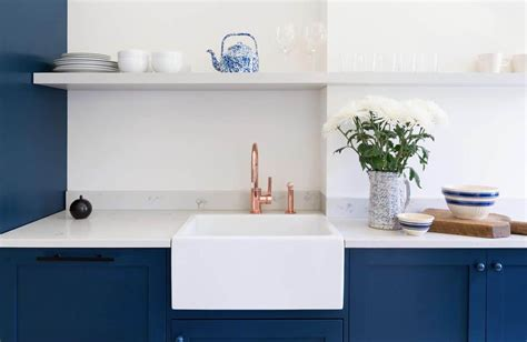 splendid cooking area featuring blue kitchen cabinets