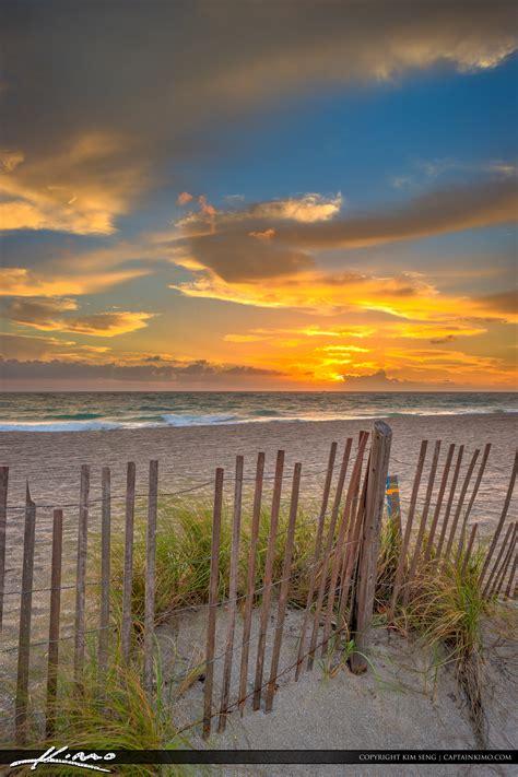 jupiter beach sunrise  ocean park   fence