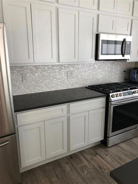 white  pearl shell tile   kitchen backsplash