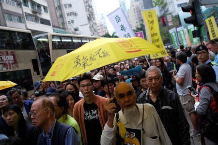 Thousands march in Hong Kong over proposed extradition law ...