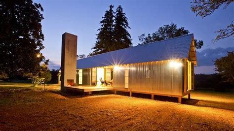 regional modern dogtrot home  corrugated metal cladding dog trot house dog trot house
