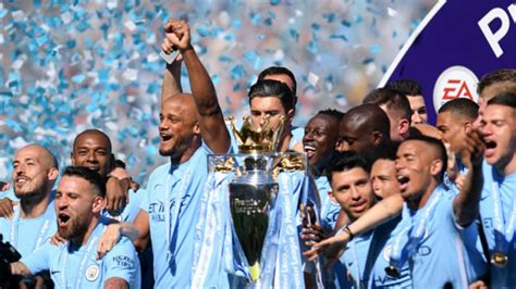 manchester city lift epl  trophy huddersfield town