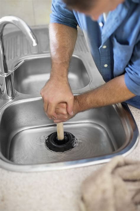 how to fix kitchen sink how to unclog a kitchen sink