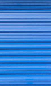 Blue roller shutter of a warehouse   Wallpaper iphone love ...