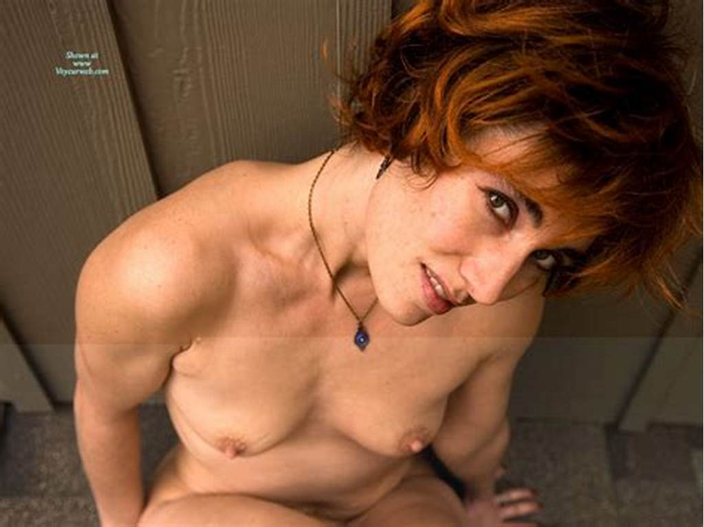 #Nude #Redhead #Sitting #Against #Wall #On #Roof