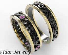 two tone gold his and hers pink sapphire wedding band set