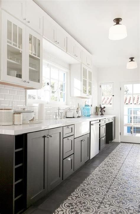 white  black kitchen features glass upper cabinets