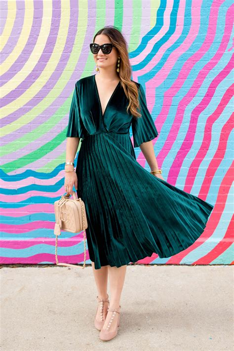 green velvet pleated fit  flare midi dress  chanel bag