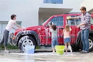Family Washing Car Together - Stock Photo