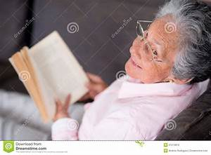 Old woman reading a book stock image. Image of hispanic ...