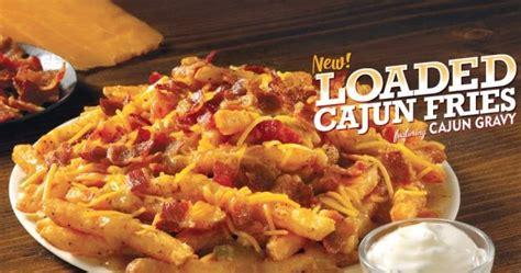 popeyes debuts  loaded cajun fries brand eating