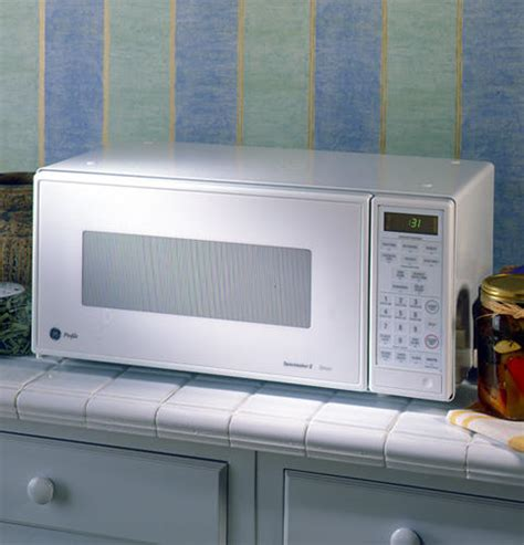 ge profile spacemaker ii  cu ft capacity microwave oven jemwa ge appliances
