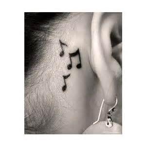 notes ear tattoo tattoo ear piercings pinterest