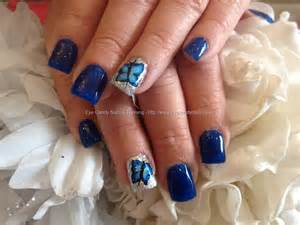 Nails training gel with blue polish and butterfly