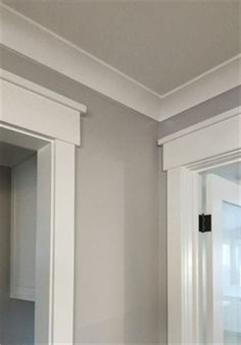 inset shaker style doors with cove crown and light crown molding pairs well with shaker style cabinetry