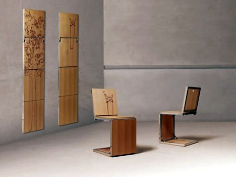 Hanging Folding Chairs On Wall by Wall Art Chair Yanko Design