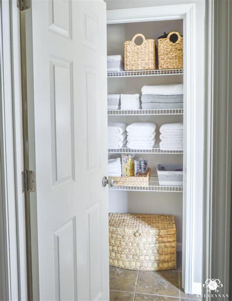 organized bathroom linen closet    kelley