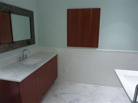 glass subway tiles bathroom white vanity with pale blue