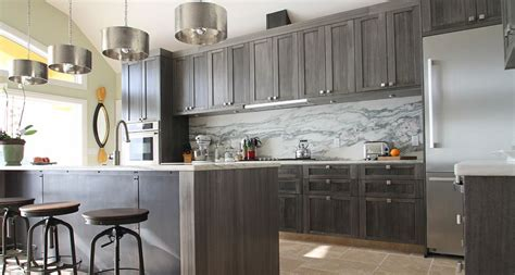 grey stained cabinetry kitchen designed  tthes