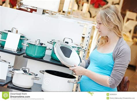 Woman Shopping At Home Appliance Supermarket Stock Photo
