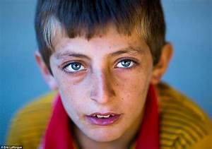 Haunting portraits of Kurdish refugees offer a striking ...