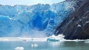 Massive Glacier Calving Creating Huge Blue Ice Wall