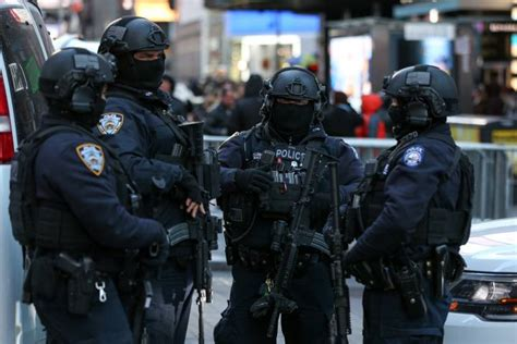 New York City Police Officers Prepare In Case Of Suicide