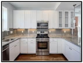 gray subway tile backsplash white cabinets home design ideas