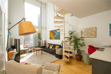 lofted duplex   foot ceilings  priced