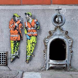 Tiny street murals by jaune unveil a world of miniature for Tiny street murals by jaune unveil a world of miniature city workers