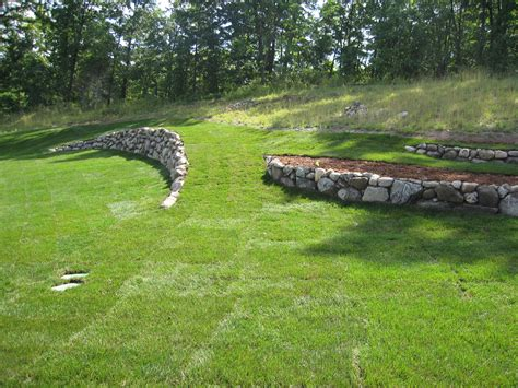 Leveling A Sloped Backyard by Boulder Retaining Walls Helping To Create A More Level